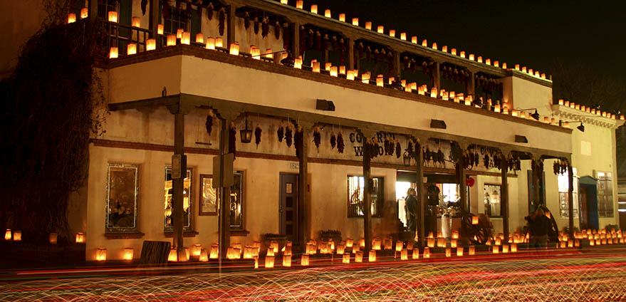 Luminarias decorate historical buildings in Old Town, Albuquerque
