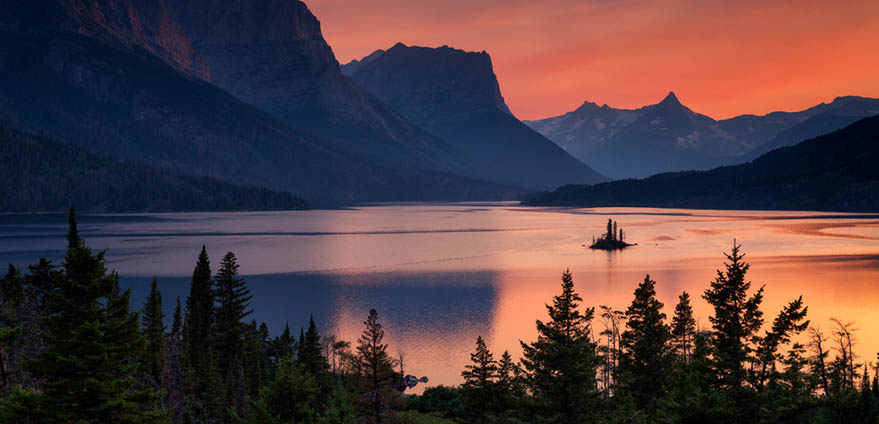 Beautiful colorful sunset over St. Mary Lake and wild goose island in Glacier national park, Montana