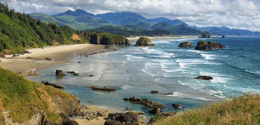 A scenic coastal view of Cannon Beach and Indian Beach in Ecola State park in Oregon