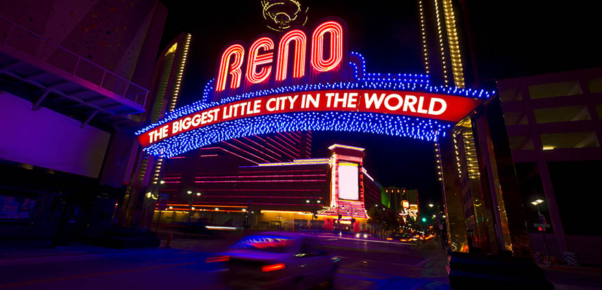 """=""""large lighted outdoor sign reading: Reno, the biggest Little City in the World"""