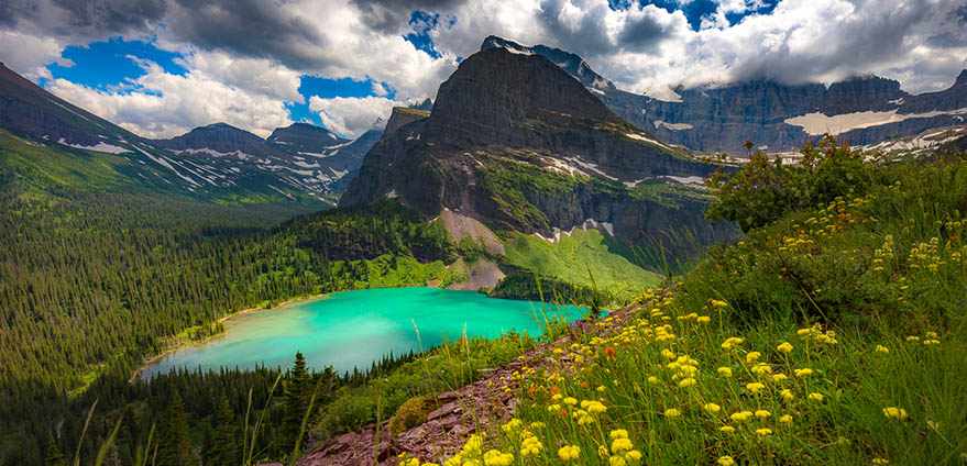 Landscape view of Grinnell Lake from overlook, Glacier National Park, Montana on partly cloudy day