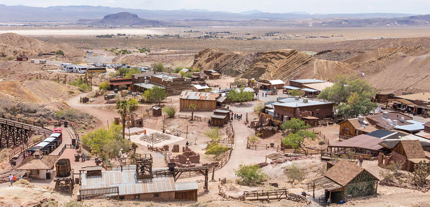 Empty buildings are seen surrounded by desert in an aerial view of Calico Ghost Town in Yermo, California