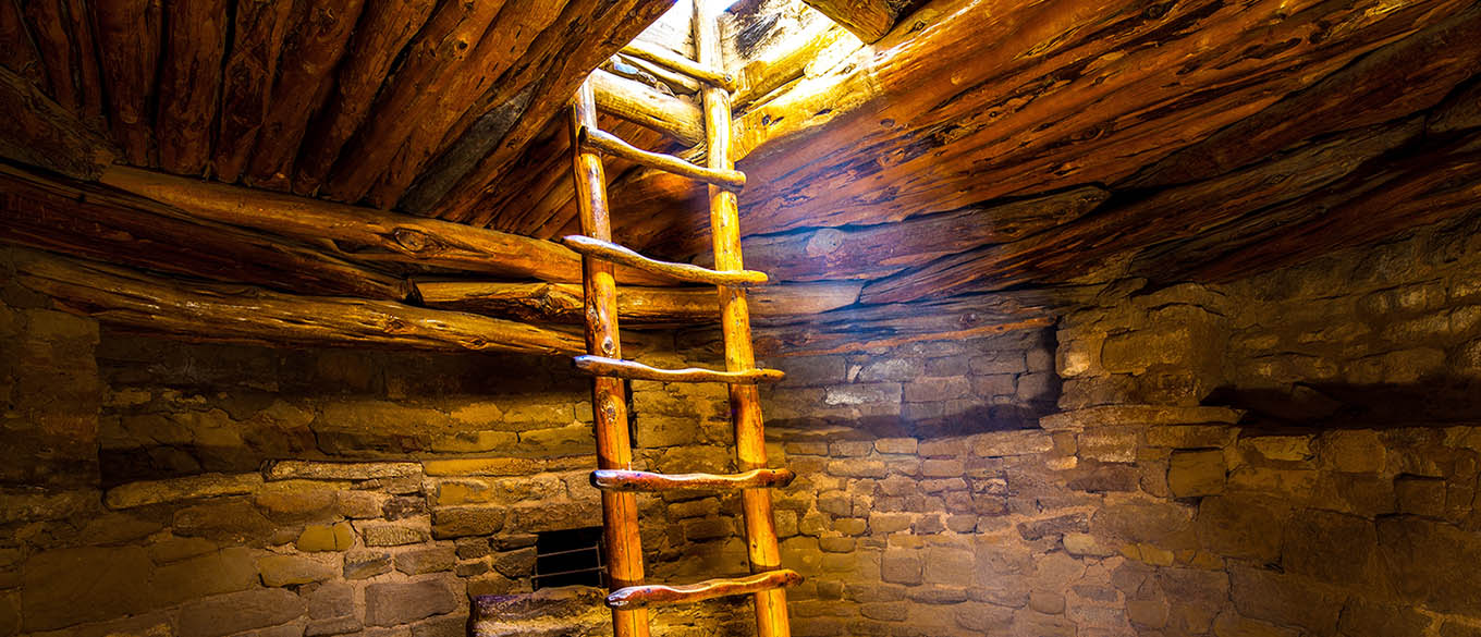 Ladder descending into kiva, Mesa Verde National Park, Colorado