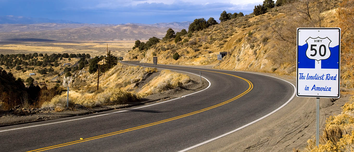 Route 50 - the loneliest road in America, Nevada under blue sky with white cloud