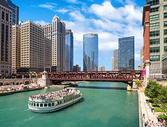 The Chicago River and downtown Chicago skyline on a bright sunny day