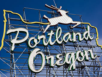 Portland, Oregon sign against a sunny, blue sky