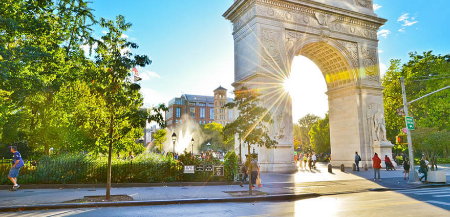 View of Washington Square Park in New York City on a clear summer afternoon.