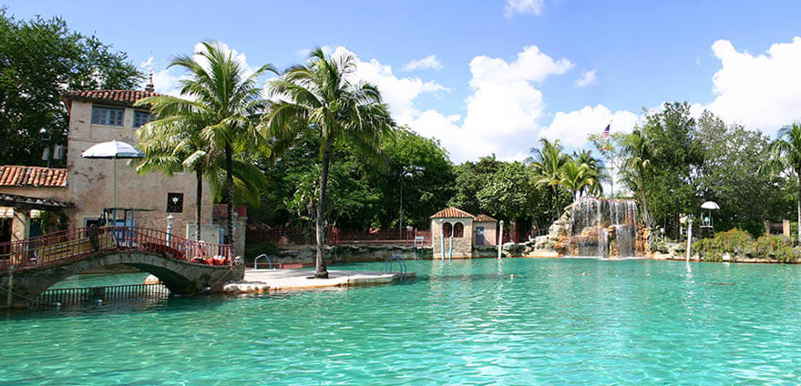 Exquisite view of Venetian Pool in Coral Gables quarter on a sunny day in Miami, Florida
