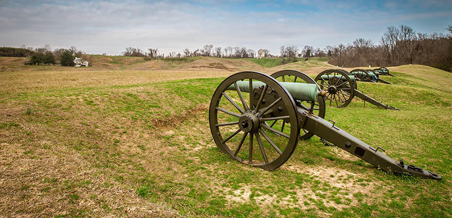 Daytime view of old Canons on the site of the American Civil War in Vicksburg National Military Park in Mississippi under blue sky