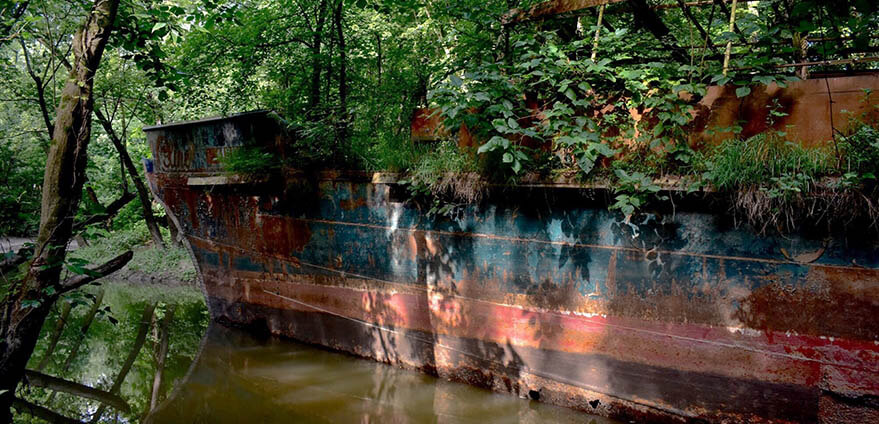 Light hits the side of The Celt as it sits in a river in Kentucky on a bright afternoon.