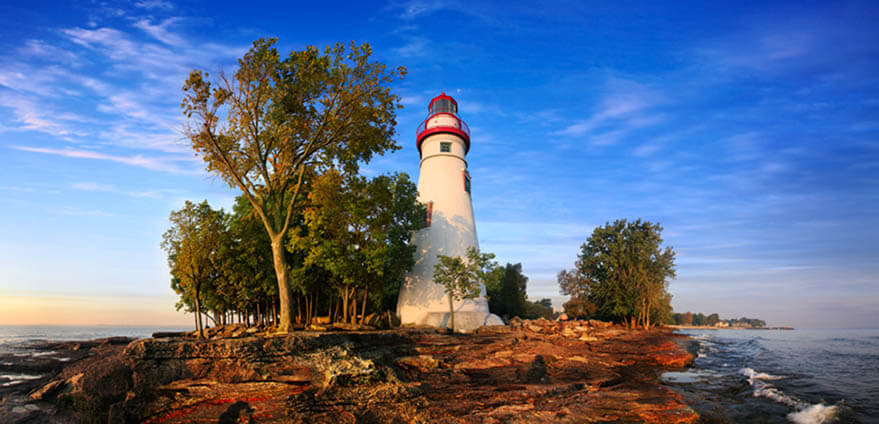 This photo shows a panoramic view of the Marblehead Lighthouse In early morning light on Lake Erie.