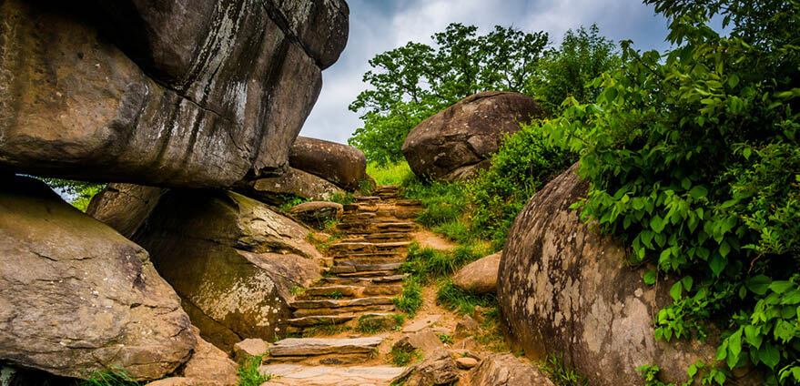 Path and boulders sit under a cloudy afternoon sky in Devil's Den, Gettysburg, Pennsylvania.