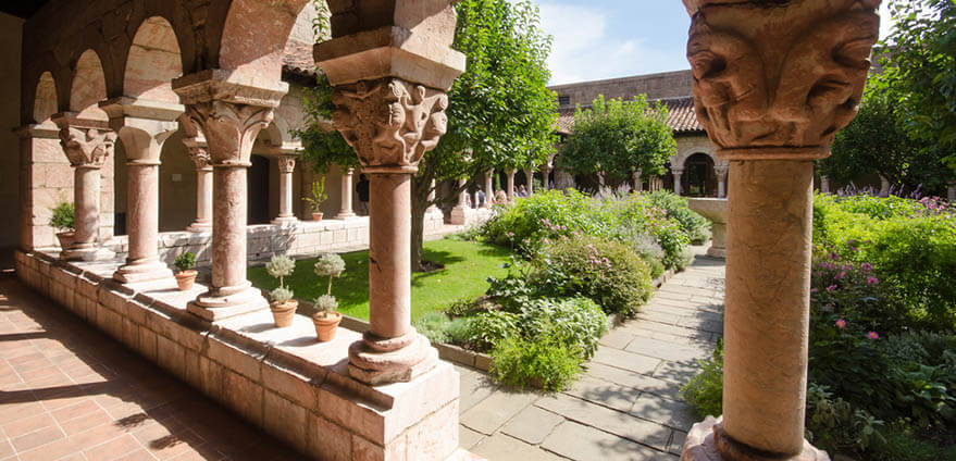 Daytime view through the arches in the Garden of Cloisters Museum in New York