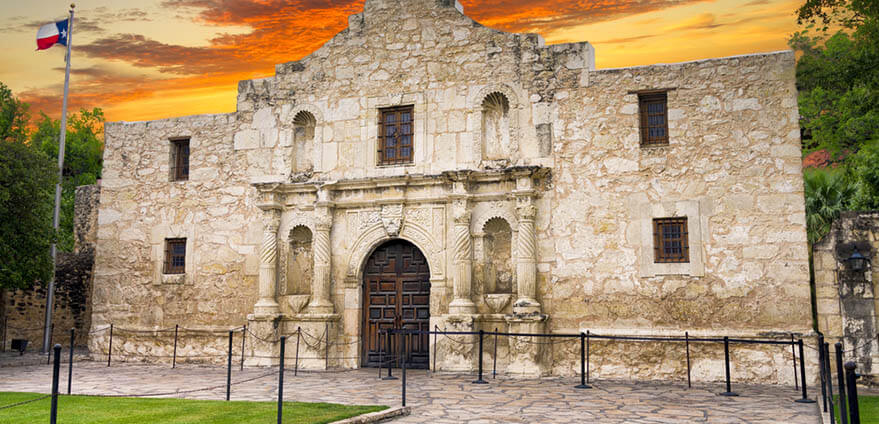 The exterior of the historic Alamo glows shortly after sunrise.