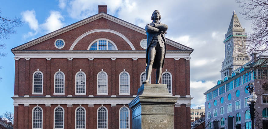 Daytime view of the statue of Sam Adams outside of Faneuil Hall in Boston, Massachusetts
