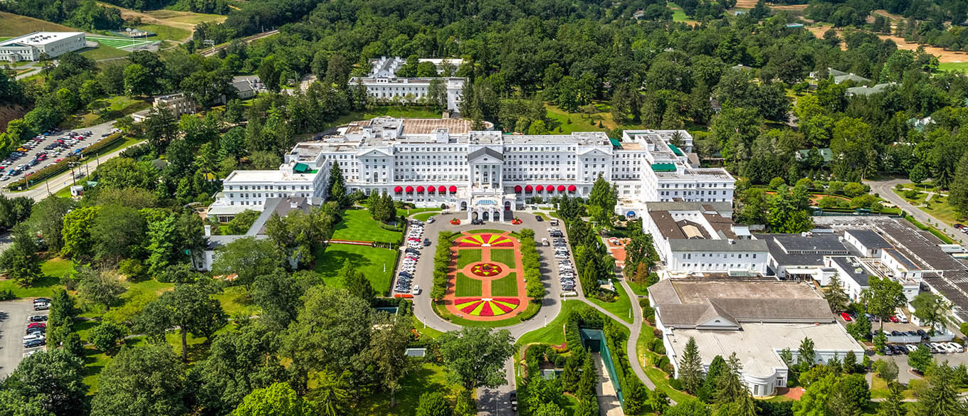 An aerial view of the lush green surroundings of Greenbrier Resort in White Sulphur Springs, WV on a bright morning