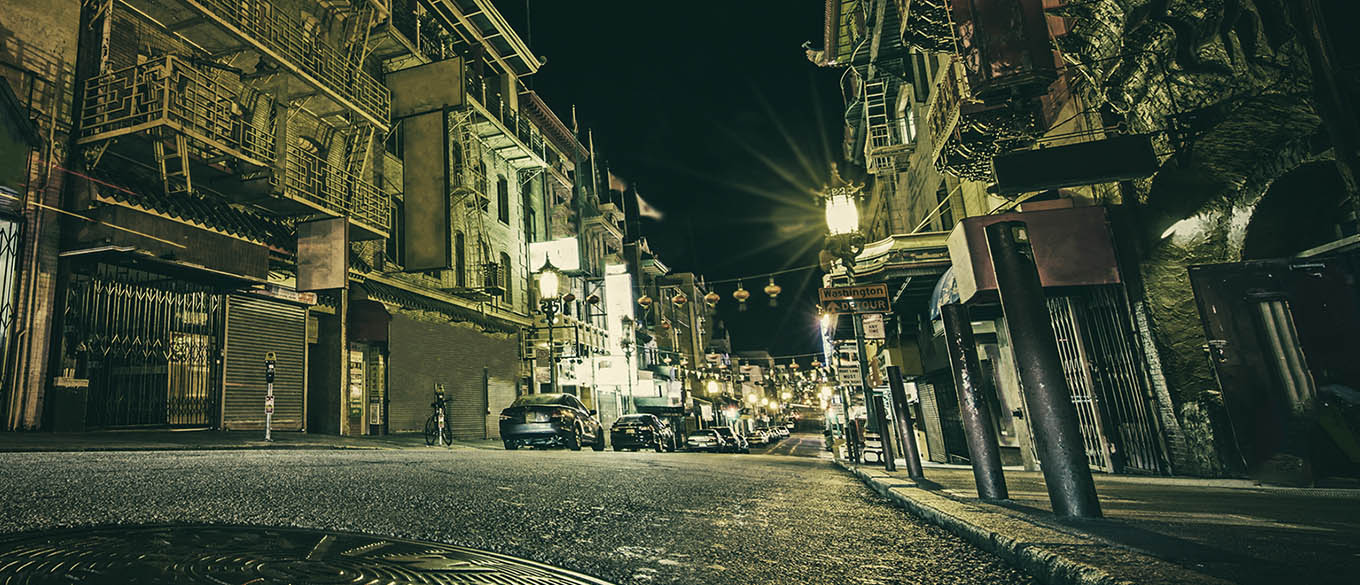 Neo noir style image of Chinatown at night in San Francisco.
