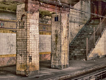 An old New York City Subway station sits empty on a cold morning.