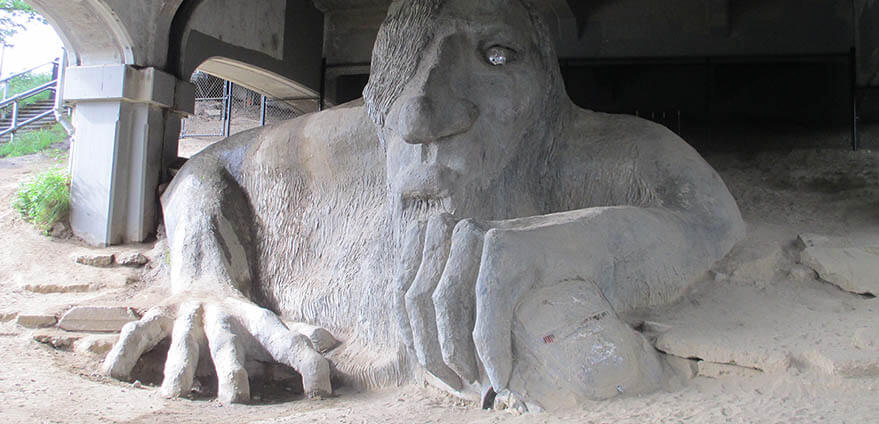 Daytime shot of the famous Fremont Troll under the Aurora Bridge in Seattle