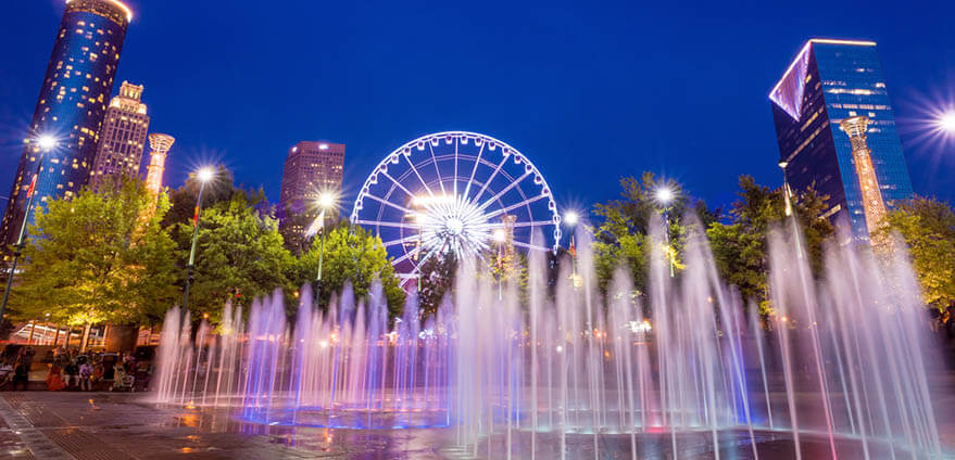 Fountain display in Centennial Olympic Park in Atlanta, Georgia, illuminated in the evening.